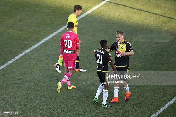 Hamish Watson of the Phoenix celebrates with his team mate Roy Krishna after scoring a goal during the round six ALeague match between the Central...