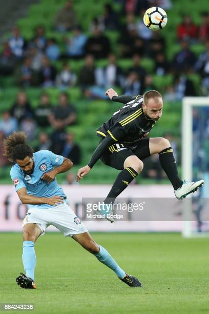 Hamish Watson of Wellington Phoenix heads the ball over Osama Malik of the City during the round three ALeague match between Melbourne City and the...