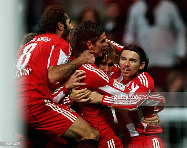 Hamit Altintop Mario Gomez Andreas Ottl and Danijel Pranjic of Bayern Muenchen celebrate Gomez' first goal with teammates during the Bundesliga match...