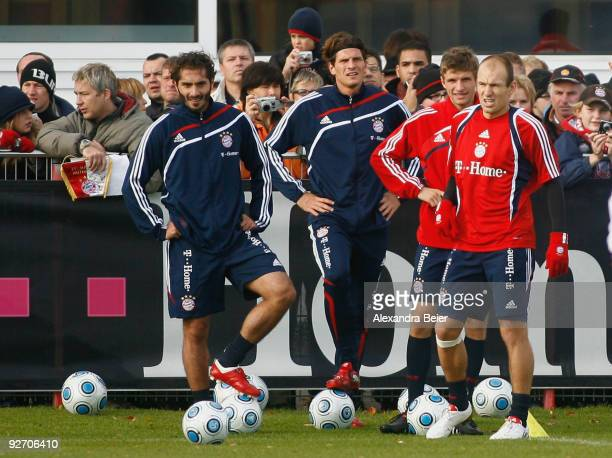 Hamit Altintop Mario Gomez Thomas Mueller and Arjen Robben of Bayern Muenchen warm up during a training session on November 4 2009 in Munich Germany...