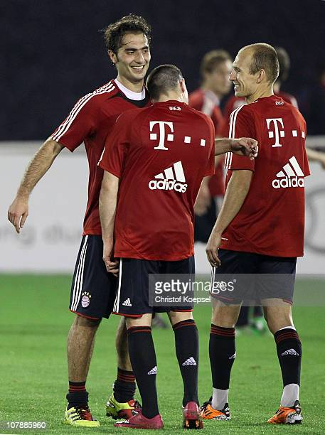 Hamit Altintop of Bayern and Franck Ribery of Bayern make nonsense during the FC Bayern Muenchen training session at Aspire Academy for Sports...