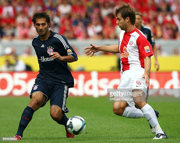 Hamit Altintop of Bayern tackles Andreas Ivanschitz of Mainz during the Bundesliga match between FSV Mainz 05 and FC Bayern Muenchen at Bruchweg...