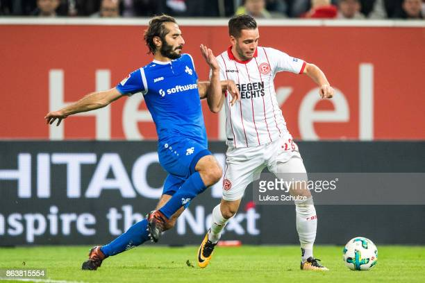 Hamit Altintop of Darmstadt and Niko Giesselmann of Duesseldorf fight for the ball during the Second Bundesliga match between Fortuna Duesseldorf and...