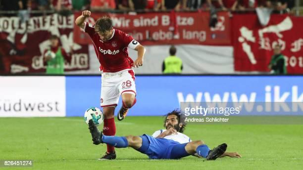 Hamit Altintop of Darmstadt challenges Daniel Halfar of Kaiserslautern during the Second Bundesliga match between 1 FC Kaiserslautern and SV...