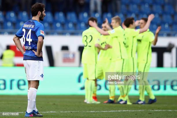 Hamit Altintop of Darmstadt reacts as players of Augsburg celebrate after the Bundesliga match between SV Darmstadt 98 and FC Augsburg at...