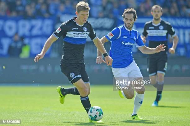 Hamit Altintop of Darmstadt tackles Fabian Klos of Bielefeld during the Second Bundesliga match between SV Darmstadt 98 and DSC Arminia Bielefeld at...