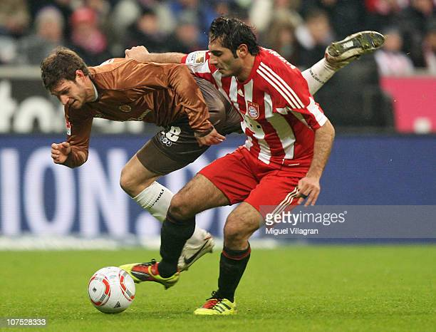 Hamit Altintop of FC Bayern Muenchen and Moritz Volz of FC St Pauli challenge for the ball during the Bundesliga match between FC Bayern Muenchen and...