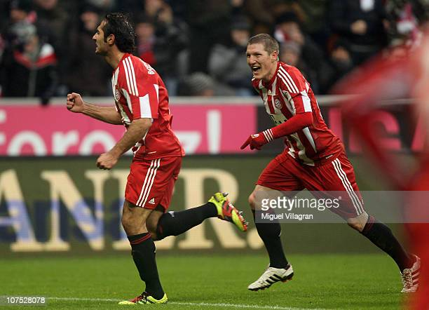 Hamit Altintop of FC Bayern Muenchen celebrates his side's first goal with his team mate Bastian Schweinsteiger during the Bundesliga match between...
