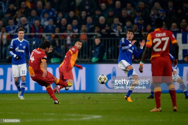 Hamit Altintop of Galatasaray scores his team's first goal during the UEFA Champions League round of 16 second leg match between Schalke 04 and...