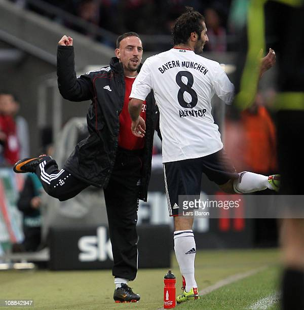 Hamit Altintop of Muenchen celebrates with Franck Ribery after scoring his team's second goal during the Bundesliga match between 1 FC Koeln and FC...