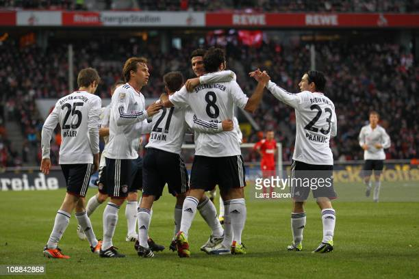 Hamit Altintop of Muenchen celebrates with Mario Gomez and other team mates after scoring his teams second goal during the Bundesliga match between 1...