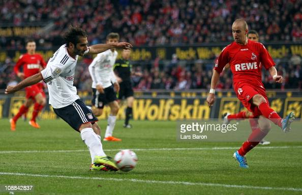 Hamit Altintop of Muenchen scores his teams second goal past Miso Brecko of Koeln during the Bundesliga match between 1 FC Koeln and FC Bayern...