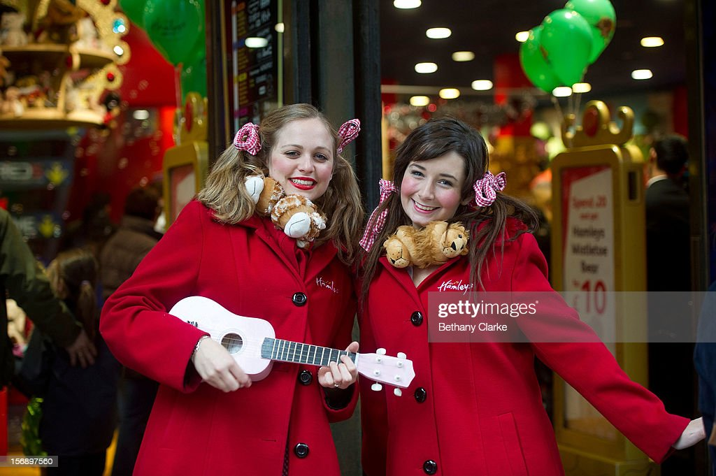 Hamleys employees sing to shoppers outside Hamleys Toy Store on November 24, 2012 in London, England. Oxford Street was closed to traffic for its annual pedestrian only Christmas Shopping.