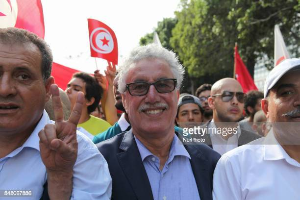 Hamma Hammami spokesman of Popular Front makes a victory sign as he attends a march held under the slogan firmness against the mafia regime by the...