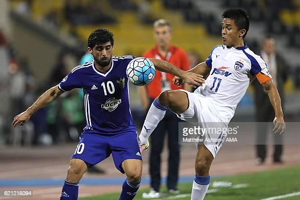 Hammadi Ahmad of AlQuwa AlJawiya of Iraq competes with Sunil Chhetri of Bengaluru FC of India during the AFC Cup Final match between JSW Bengaluru...