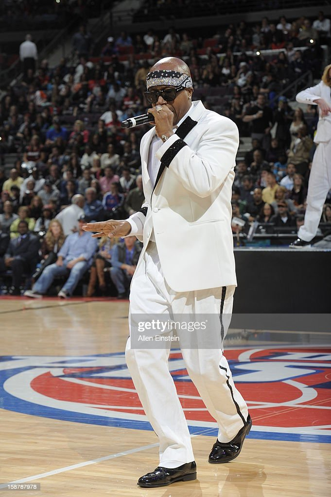 MC Hammer , American rapper, entrepreneur, spokesman, and actor raps to the crowd during half time of the Detroit Pistons , Miami Heat during the game on December 28, 2012 at The Palace of Auburn Hills in Auburn Hills, Michigan.