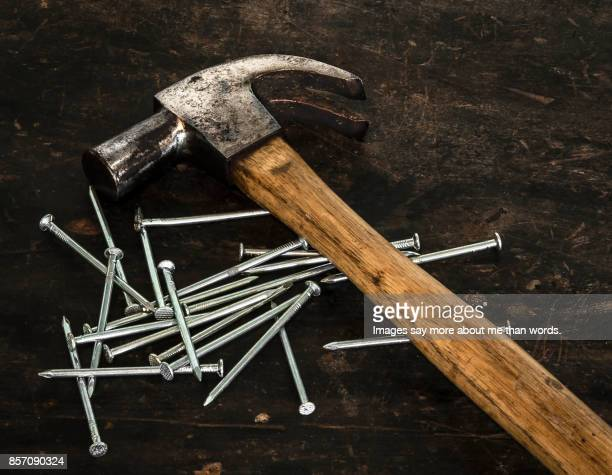 A hammer and a lot of nails. Still life.