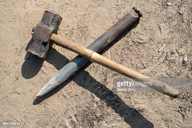 Hammer and chisel on sand