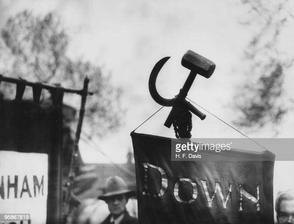 A hammer and sickle attached to a banner at a May Day Labour demonstration 1st May 1928