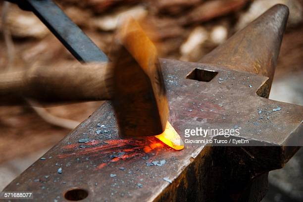 Hammer Hitting Iron On Anvil