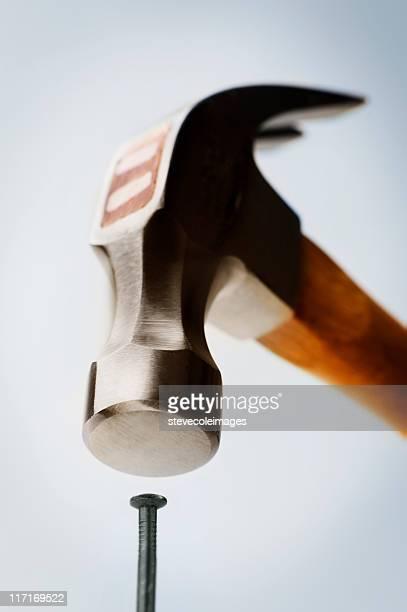 Hammer Hitting Nail Head