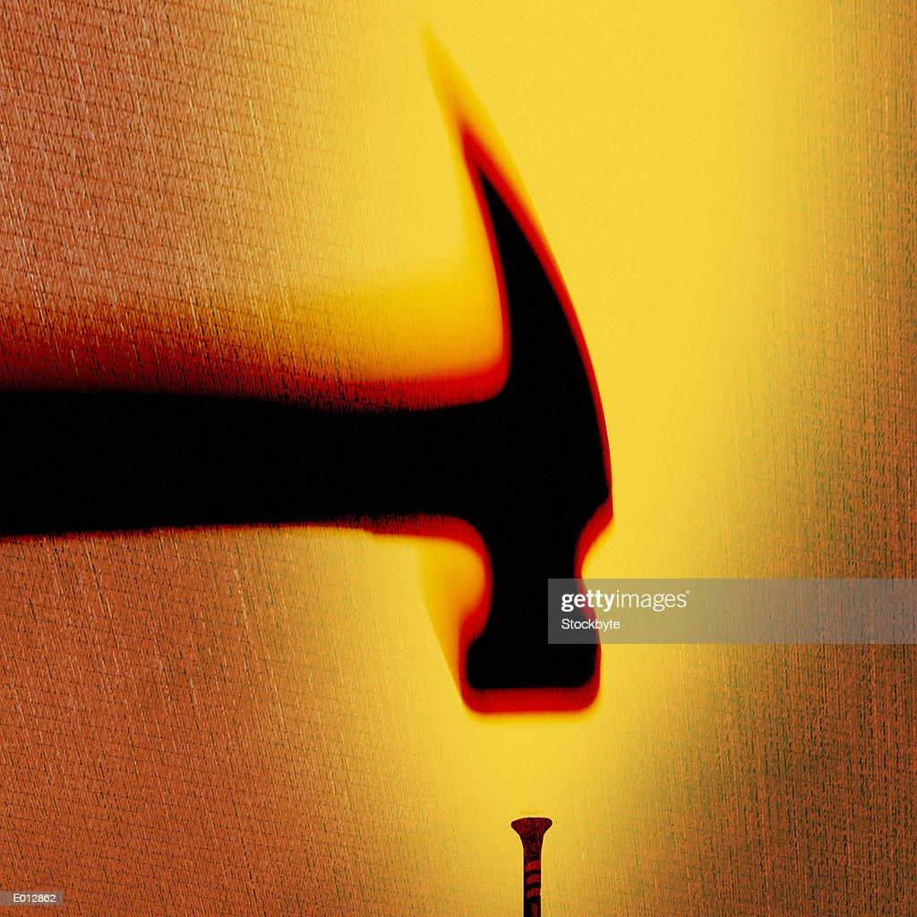 Hammer hitting nail : Stock Photo