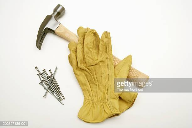 Hammer, nails and work gloves