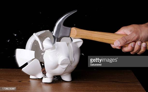Hammer Smashing Piggybank Full of Coins