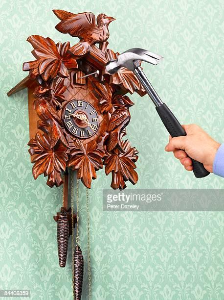 Hammering nail into cuckoo clock