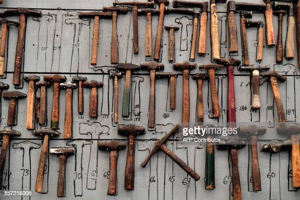 Hammers of different sizes and weights are displayed in the workshop of the manufacturer of the silver formula one trophies during a tour offered by...