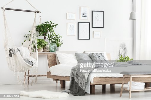 Hammock and posters in bedroom : Stock Photo