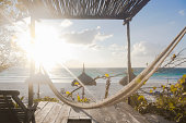 Hammock at sunrise at beach and Ocean