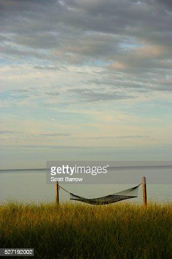 Hammock beside a quiet lake : Stock Photo