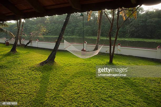 Hammock in a garden at the canal side Kerala Backwaters Alappuzha District Kerala India