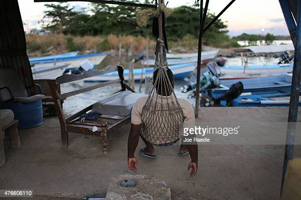 A hammock is used to relax as the country is consumed with reports that former Fifa vicepresident Jack Warner was corrupted as he worked in the...