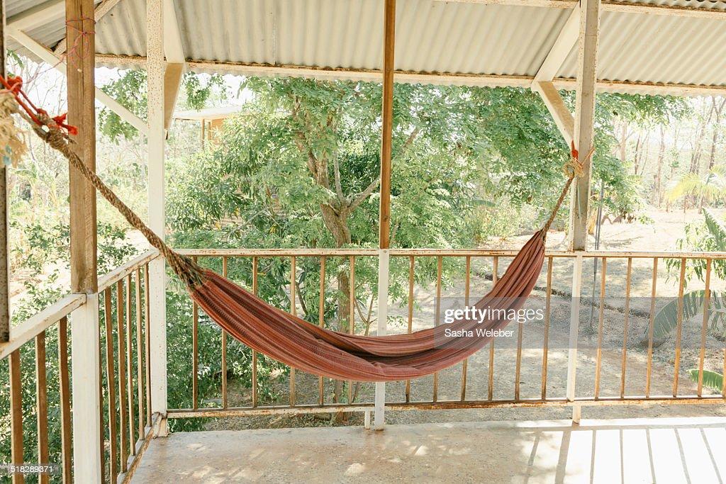 Hammock on balcony with jungle stock photo getty images for Balcony hammock
