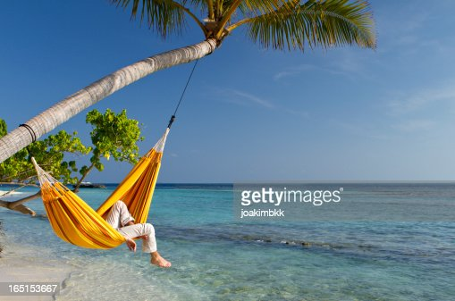 Caribbean Relaxation: Hammock Relaxation By The Sea Stock Photo