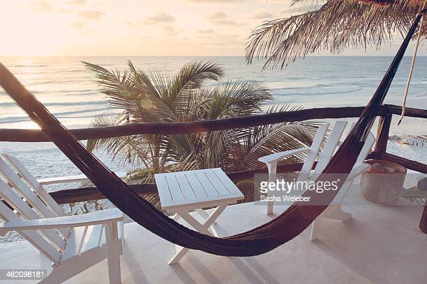 Hammock with chairs and table overlooking ocean