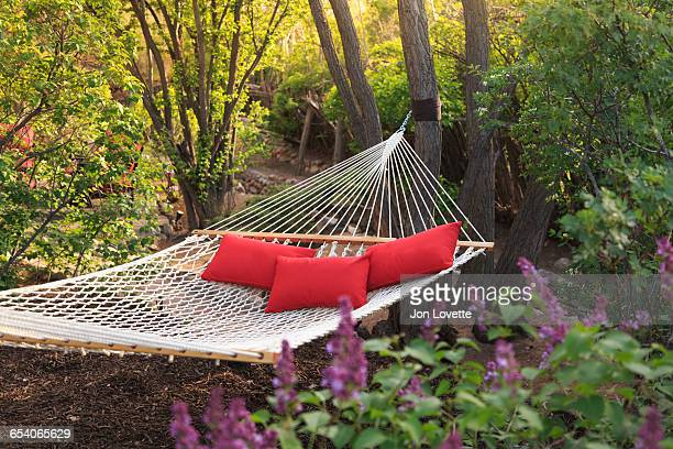 hammock with three red pillows
