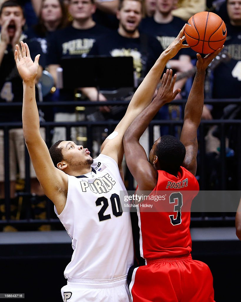 A.J. Hammons #20 of the Purdue Boilermakers blocks the ball of Marcus Posley #3 of the Ball State Cardinals at Mackey Arena on December 18, 2012 in West Lafayette, Indiana. Purdue defeated Ball State 66-56.