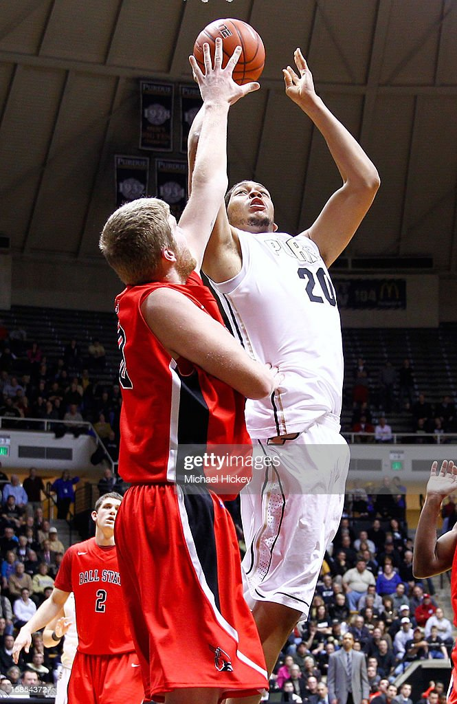A.J. Hammons #20 of the Purdue Boilermakers shoots against Zach Fields #50 of the Ball State Cardinals at Mackey Arena on December 18, 2012 in West Lafayette, Indiana. Purdue defeated Ball State 66-56.