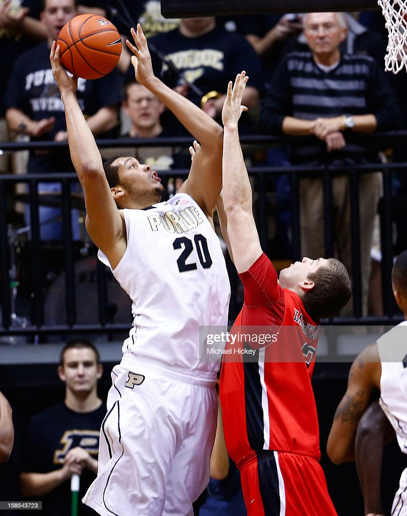 A.J. Hammons #20 of the Purdue Boilermakers shoots the ball against Matt Kamieniecki #2 of the Ball State Cardinals at Mackey Arena on December 18, 2012 in West Lafayette, Indiana. Purdue defeated Ball State 66-56.