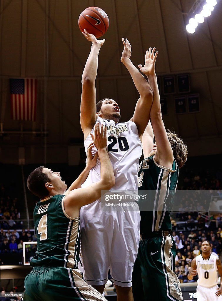 A.J. Hammons #20 of the Purdue Boilermakers shoots the ball against Matt Rum #4 and Tim Rusthoven #22 of the William & Mary Tribe at Mackey Arena on December 29, 2012 in West Lafayette, Indiana.