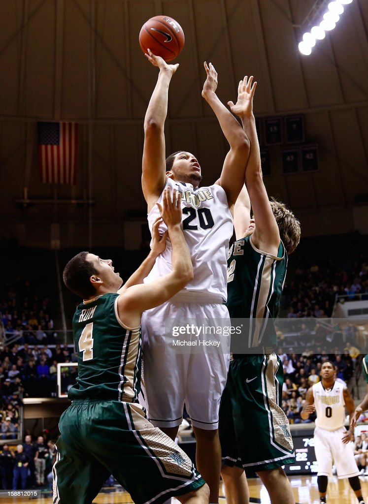 A.J. Hammons #20 of the Purdue Boilermakers shoots the ball against Matt Rum #4 of the William & Mary Tribe and Tim Rusthoven #22 of the William & Mary Tribe at Mackey Arena on December 29, 2012 in West Lafayette, Indiana. Purdue defeated William & Mary 73-66.