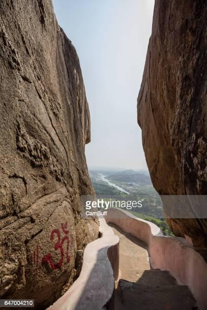 Hampi village seen through big boulders, from the stairway to Anjaneya hills.