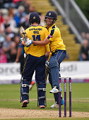 Hampshire batsman James Vince celebrates his century with Sean Ervine during the NatWest T20 Blast quarter final match between Worcestershire and...