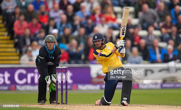 Hampshire batsman James Vince hits out watched by Ben Cox during the NatWest T20 Blast quarter final match between Worcestershire and Hampshire at...