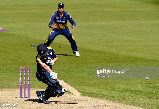 Hampshire batsman Jimmy Adams is hit by a short ball from Michael Hogan and subsequently the match is abandoned due to a dangerous pitch during the...