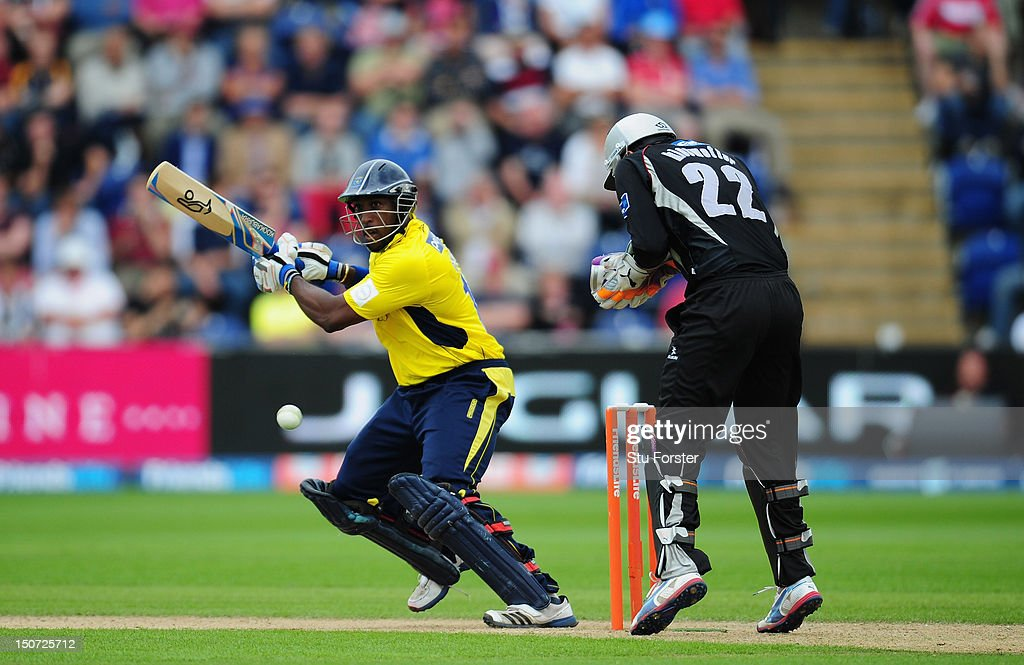 Hampshire batsman Michael Carberry hits a ball towards the boundary watched by Somerset keeper Craig Kieswetter during the Friends Life T20 Semi Final between Hampshire and Somerset at SWALEC Stadium on August 25, 2012 in Cardiff, Wales.