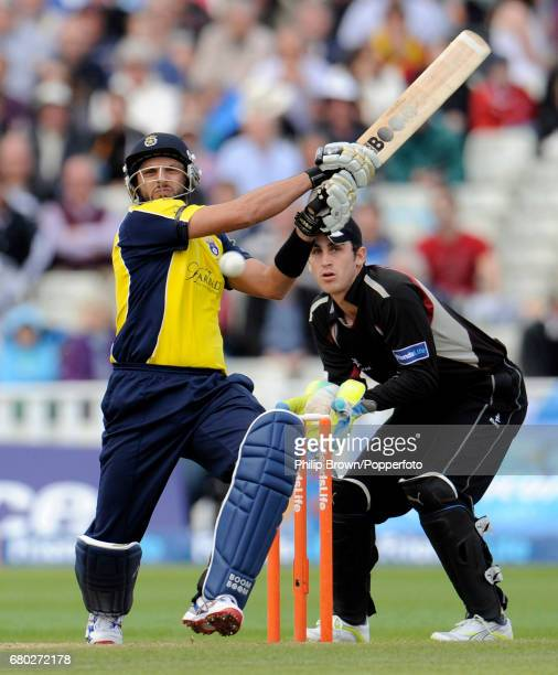 Hampshire batsman Shahid Afridi hits out watched by Somerset's Craig Kieswetter during the second Twenty20 semi final against at Edgbaston on the...